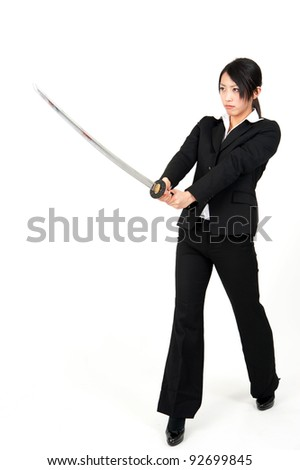 asian businesswoman with japanese samurai sword isolated on white background