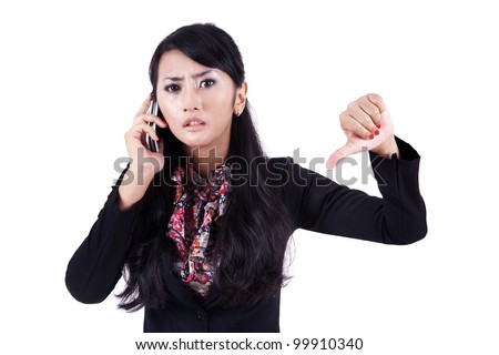 Asian businesswoman with mobile phone and thumb down