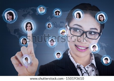 Asian businesswoman with social networking map  - stock photo