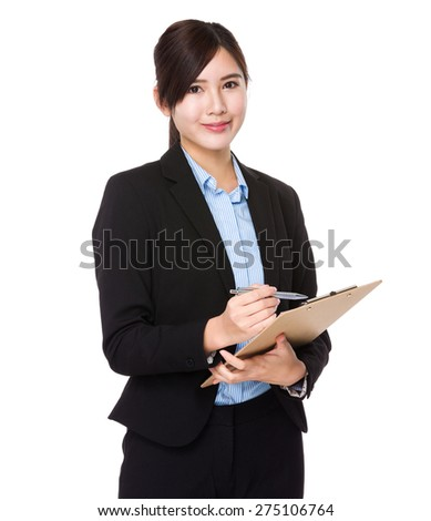 Asian businesswoman write on the clipboard