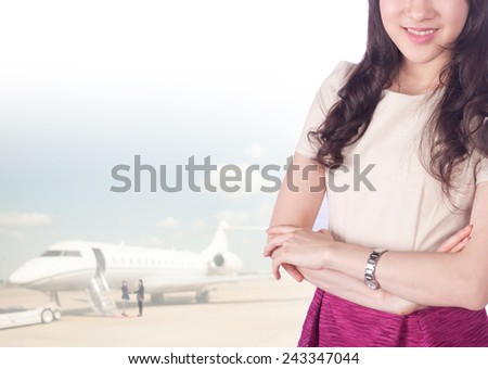 asian businesswomen has background of airport - stock photo