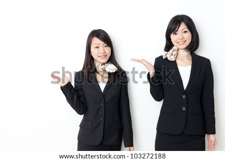 asian businesswomen showing on white background - stock photo