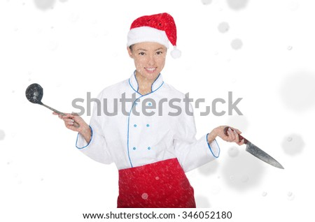 Asian chef in christmas cap with container under snow isolated on white - stock photo
