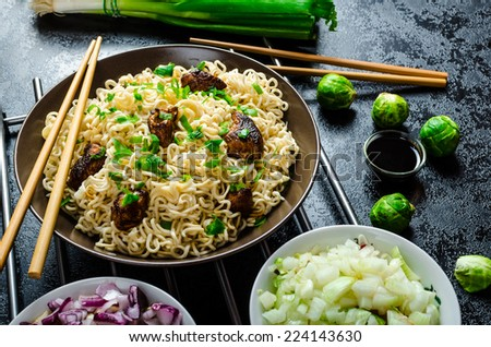 Asian chicken noodles salad, fresh onions, sprouts and spring onions - stock photo