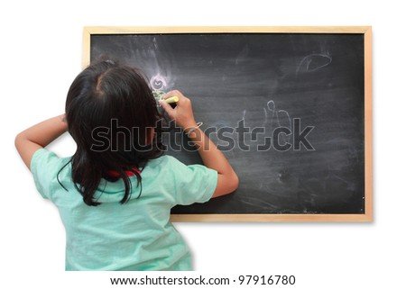 Asian child drawing with chalk at the blackboard.  isolated on white background - stock photo