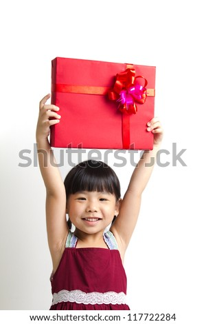 Asian child girl hold up high a red gift box - stock photo