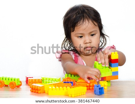 Asian Child Happy Play a Toy on White Background