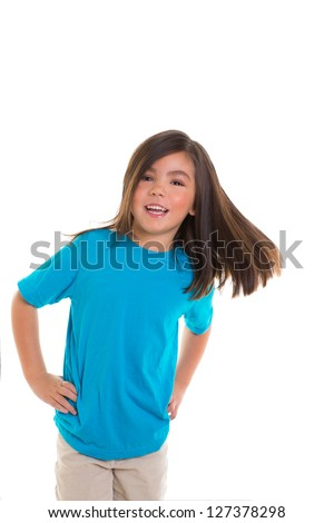 Asian child kid girl in blue happy smiling moving hair over white background - stock photo