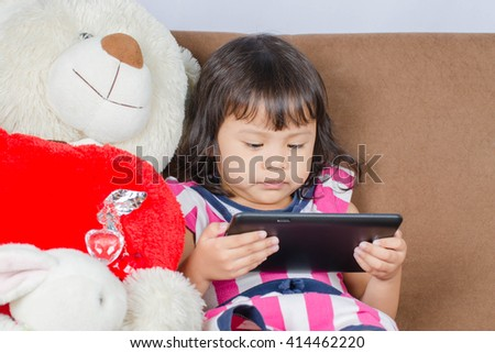 Asian Child Play A Tablet