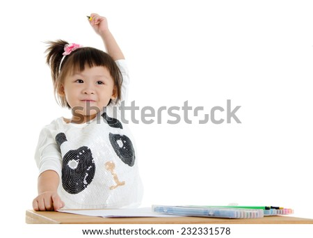 Asian child raised her hand up. Child education concept. - stock photo