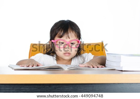 Asian Child Reading A Book On White Background