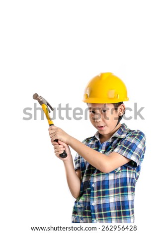 Asian child with yellow helmet and holding hammer with copyspace. - stock photo