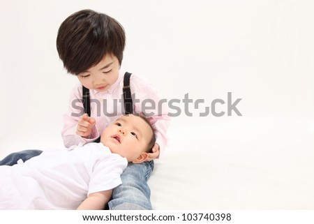 Asian children have a baby - stock photo