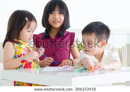 Asian children having drawing session