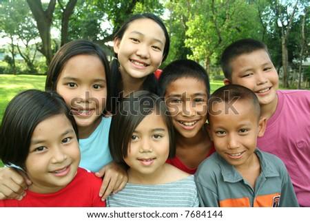 Asian children having fun in the park. - stock photo
