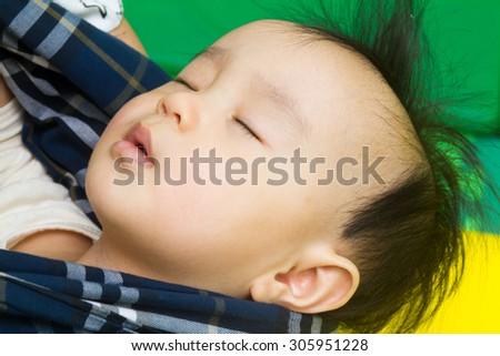Asian chinese baby girl sleeping close up. - stock photo