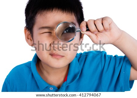 Asian Chinese Boy Holding Magnifying Glass isolated on White Background