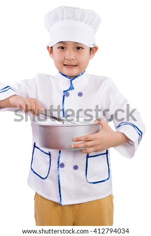 Asian Chinese Boy in white chef uniform Baking Cookies in isolated white background - stock photo