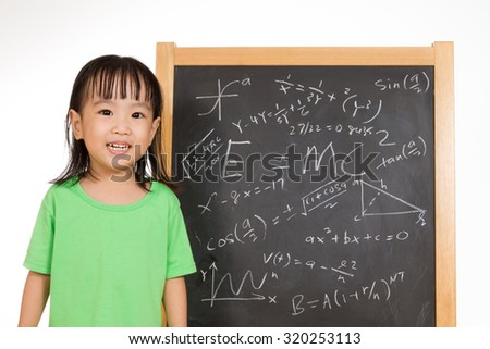 Asian Chinese children againts blackboard or chalkboard with formulas in plain isolated white background.
