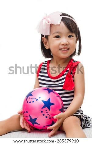 Asian Chinese Girl Holding Ball - stock photo