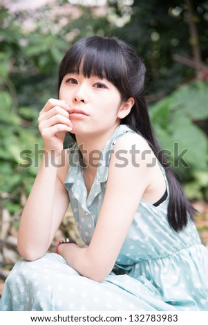 Asian Chinese girl in outdoor garden