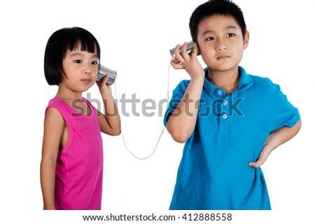 Asian Chinese Kid Playing with Tin Can Phone isolated on White Background - stock photo