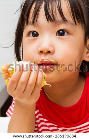 Asian Chinese little girl eating durian fruit