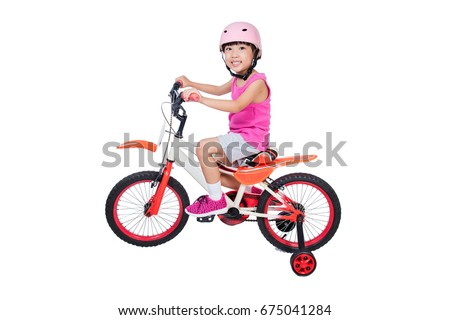 Asian Chinese little girl riding bicycle in isolated white background