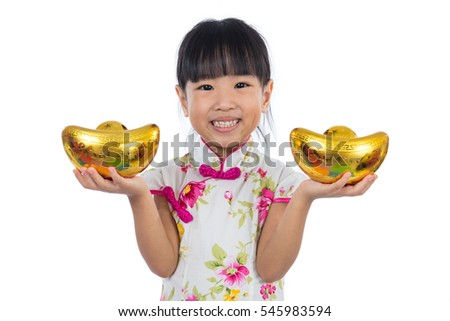 Asian Chinese little girl wearing cheongsam holding gold ingot greeting for Chinese New Year in isolated white background.