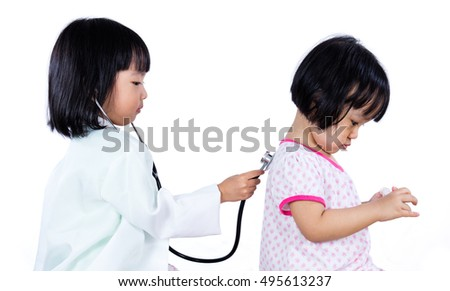 Asian Chinese Little Sister Role Playing As Doctor and Patient in isolated white background.