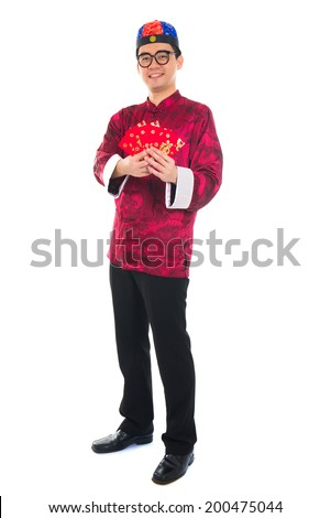 Asian Chinese man showing many red packets - stock photo