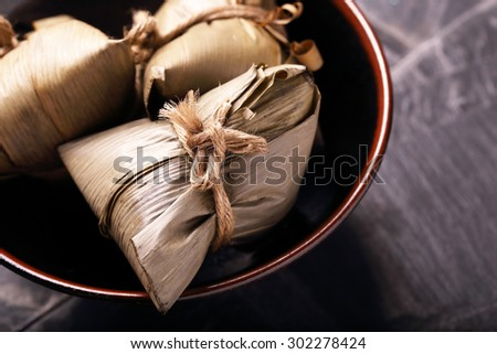 Asian Chinese Rice Dumpling, Zongzi, on Black Background. - stock photo