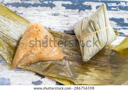 Asian Chinese rice dumplings or zongzi on old wood background - stock photo