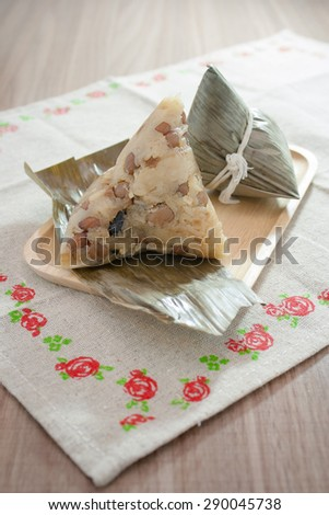 Asian Chinese rice dumplings or zongzi on wooden background - stock photo