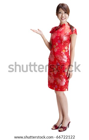 Asian Chinese woman in Traditional Chinese Cheongsam gesturing - stock photo