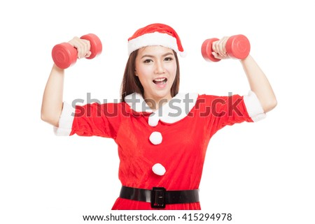 Asian Christmas girl with Santa Claus clothes and red dumbbells  isolated on white background