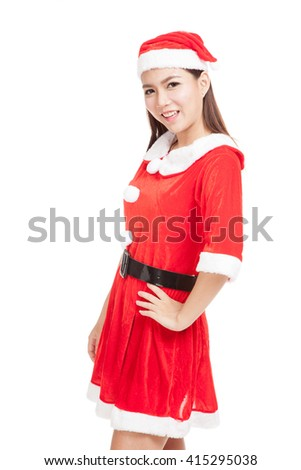 Asian Christmas girl with Santa Claus clothes  isolated on white background