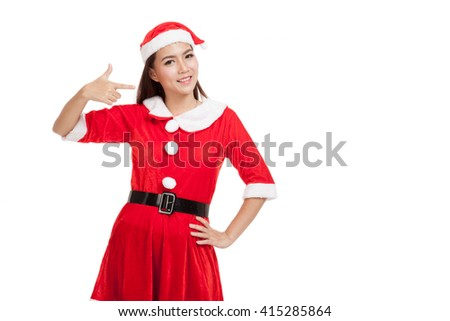 Asian Christmas girl with Santa Claus clothes point to her left  isolated on white background