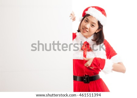 Asian Christmas Santa Claus girl thumbs up with blank sign  isolated on white background .