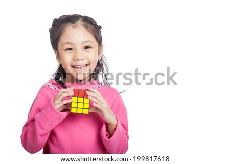 Asian  clever  little girl hold cube and laughing isolated on white background - stock photo