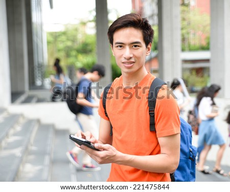 Asian college student with a mobile phone in her hand at campus