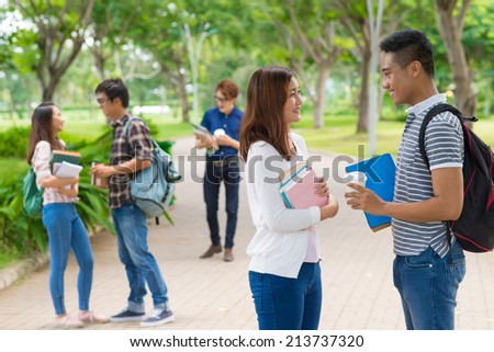 Asian college students on campus during the break - stock photo