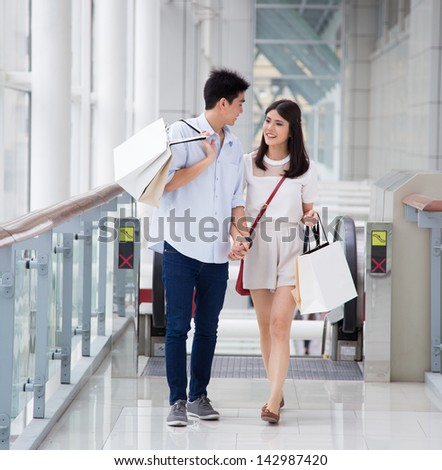Asian couple go shopping together. - stock photo