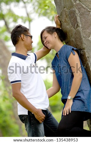 Asian Couple in face to face position