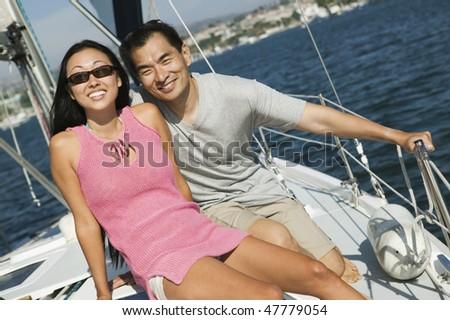 Asian Couple Sailing - stock photo