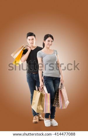 Asian couple shopping, full length portrait isolated - stock photo