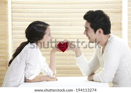 Asian couple with heart shaped box