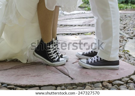 asian couple with pre wedding in the park - stock photo