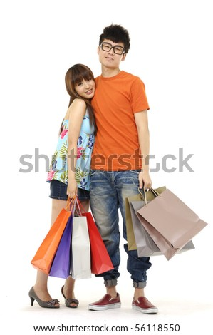 Asian couple with shopping bags isolated on white