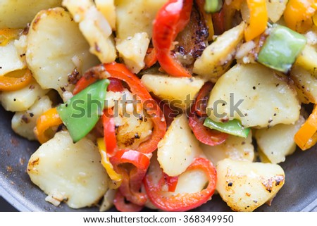 Asian cuisine healthy organic vegetable food fried in pan  Top view image at farmers breakfast with assorted vegetable like paprika chili sugar snap potato pepper ideal for food blog - stock photo